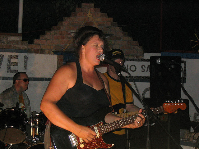 Kathy McCarty singing at the Orange Show in Houston TX 2005